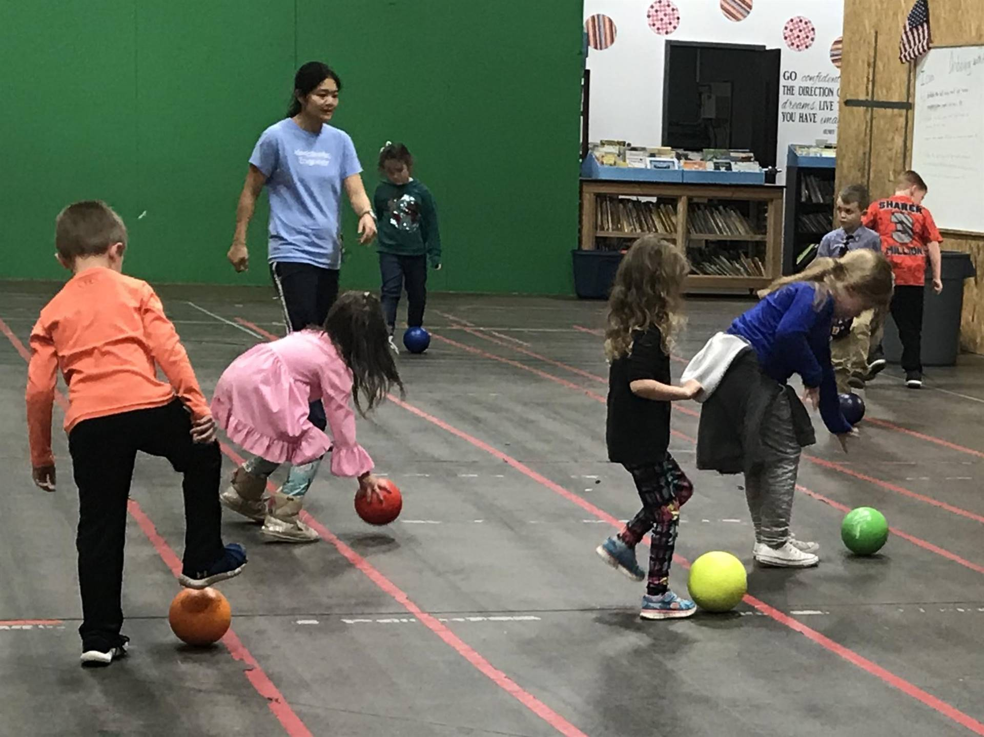 Students and a teacher playing with balls
